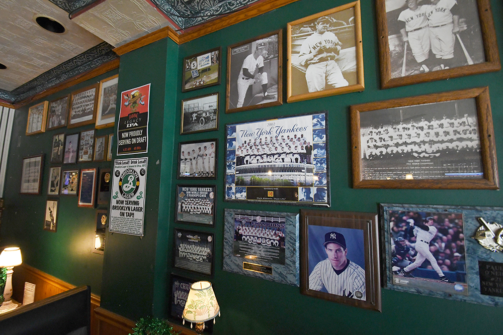Dining room wall with photos and prints of New York Yankees teams and players from the past