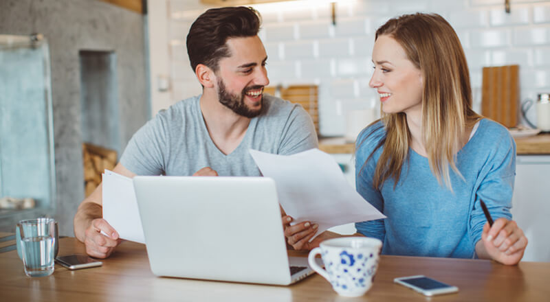Couple reviewing their finances so they can buy a home.