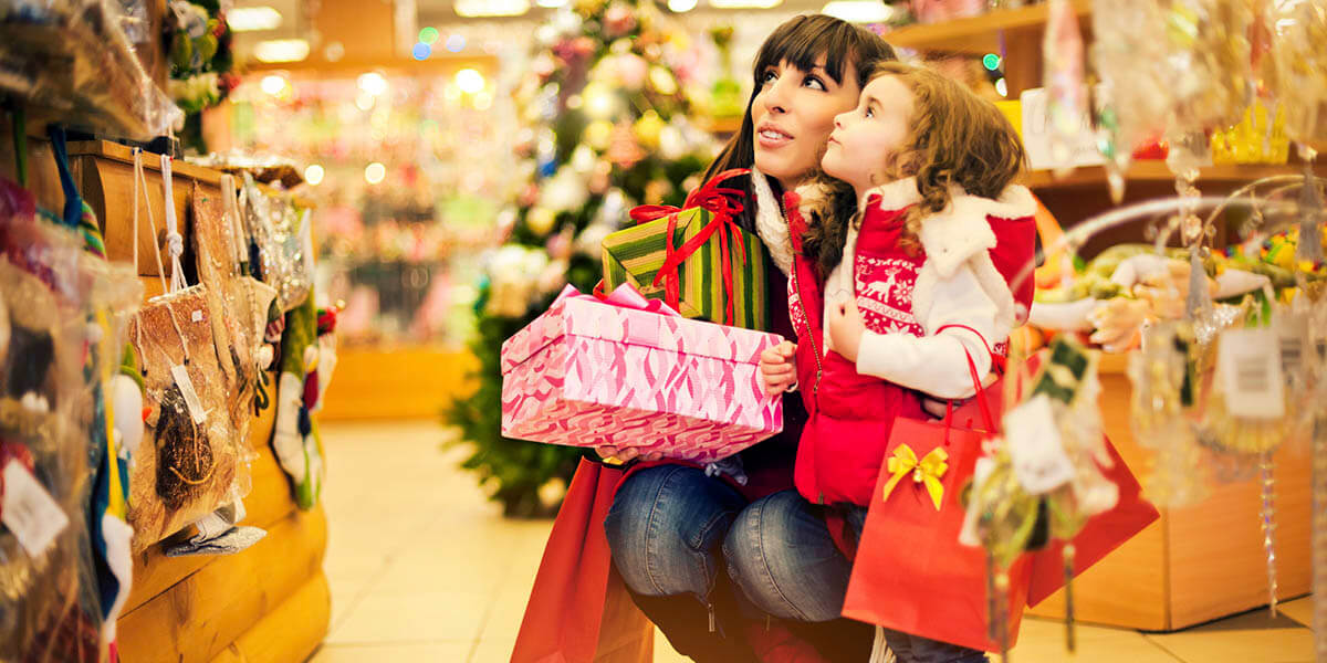 Mother and daughter buying Christmas items